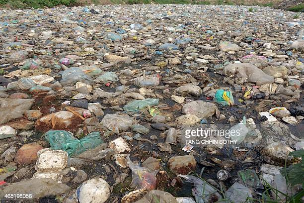 This general view shows a canal filled with waste in Phnom Penh on March 4 2015 AFP PHOTO / TANG CHHIN SOTHY