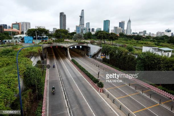 This general view shows a deserted motorway in Ho Chi Minh City on July 9 on the first day of the government imposed two-week lockdown as a...