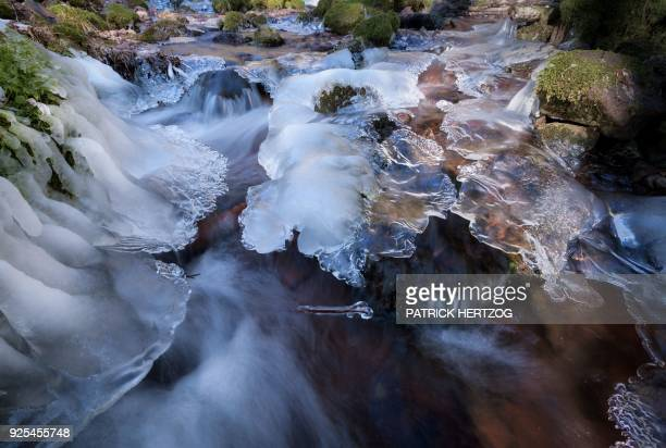 This general view shows a frozen stream in Oberhaslach eastern France on February 28 2018 Countries across Europe shut schools and rushed to shelter...