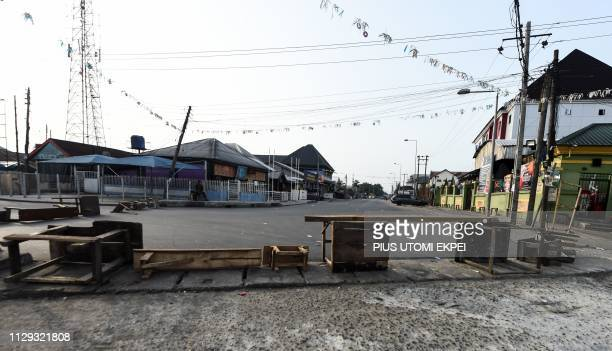This general view shows a road blocked by soldiers with wooden planks in Port Harcourt Rivers State on March 9 during voting to elect governors and...