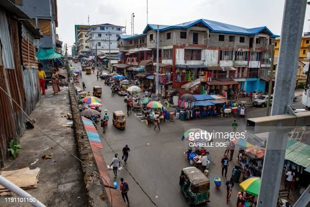 This general view shows a semi-deserted Mechlin street in Monrovia, an otherwise busy thoroughfare, on December 30, 2019 during a planned march by...