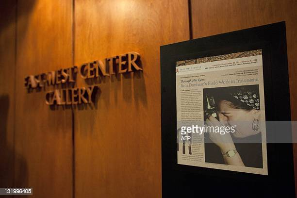 This general view shows an exhibition with photographs illustrating fieldwork in Indonesia by S Ann Dunham US President Barack Obama's late mother at...