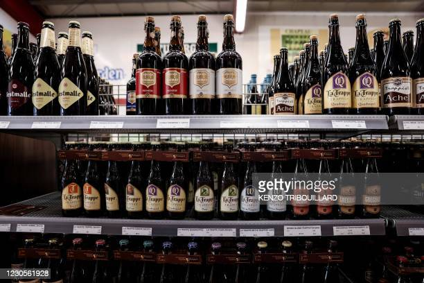 This general view shows Belgian beers on display at Rotsaert Drankencentrale, a beer store in Zedelgem, on January 12, 2021. - Trappist, Gueuze......