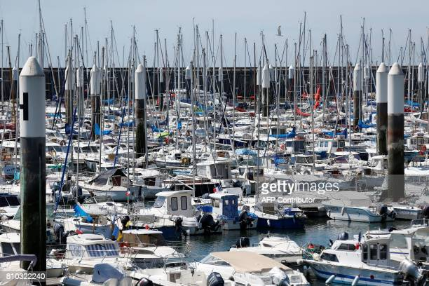 This general view shows boats moored in Le Havre northwestern France on July 7 2017 / AFP PHOTO / CHARLY TRIBALLEAU