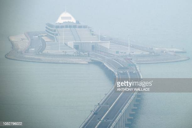 TOPSHOT This general view shows cars parked on a section of the Hong KongZhuhaiMacau Bridge in front of the East Artificial Island in Hong Kong on...