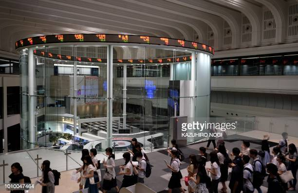 This general view shows college students visiting the Tokyo Stock Exchange in Tokyo on August 3 2018 Tokyo's key Nikkei index closed flat on August 3...