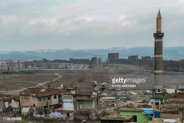 This general view shows damaged buildings in the historic Sur district, a UNESCO world heritage site, in the Kurdish-majority city of Diyarbakir on...