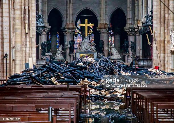 TOPSHOT This general view shows debris inside the NotreDamede Paris Cathedral in Paris on April 16 a day after a fire that devastated the building in...