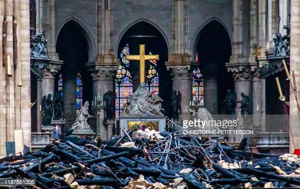 This general view shows debris inside the Notre-Dame-de Paris Cathedral in Paris on April 16 a day after a fire that devastated the building in the...
