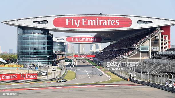 This general view shows drivers taking the first bend in the early laps of the Formula One Chinese Grand Prix in Shanghai on April 12 2015 AFP PHOTO...