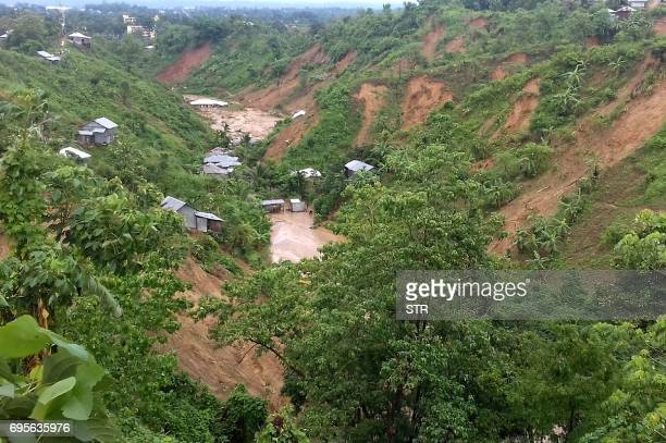 This general view shows dwellings under mud after a landslide in Rangamati on June 13 2017 Heavy monsoon rains and landslides have killed at least...