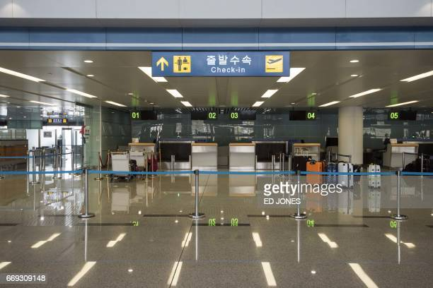 This general view shows empty checkin desks at Pyongyang airport on April 17 2017 Tourists and foreign journalists who attended the huge military...