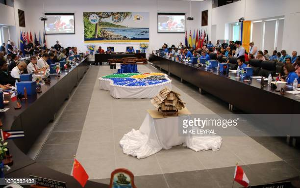This general view shows leaders gathered for the Pacific Islands Forum at the Civic Center in Aiwo on the island of Nauru on September 4 2018 Pacific...