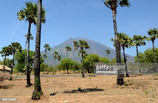 This general view shows Mount Agung volcano from the Kubu subdistrict in Karangasem Regency on Indonesia's resort island of Bali on October 6 2017...