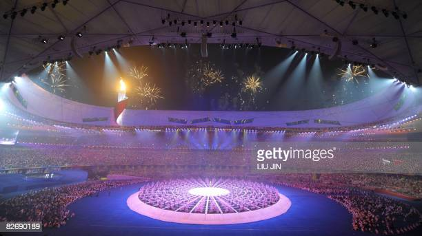 This general view shows performers during the opening ceremony for the 2008 Beijing Paralympic Games at the National Stadium also known as the Bird's...