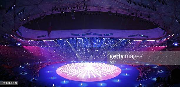 This general view shows performers taking part in the 2008 Beijing Paralympic Games opening ceremony at the National Stadium better known as the...