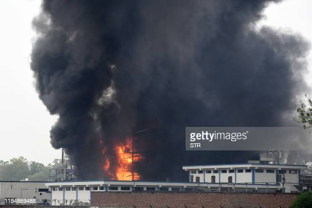 This general view shows smoke billowing from a pharmaceutical factory after a fire broke out following an explosion in Dera Bassi some 24 kms from...