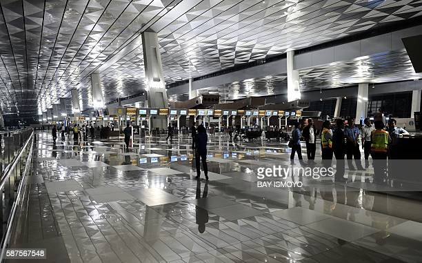 TOPSHOT This general view shows the checkin hall at the newly opened terminal 3 at SoekarnoHatta International Airport in Tangerang on the outskirts...