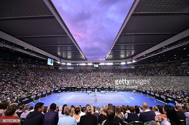 TOPSHOT This general view shows the crowd watching as Serena Williams of the US plays against Angelique Kerber of Germany in their women's singles...
