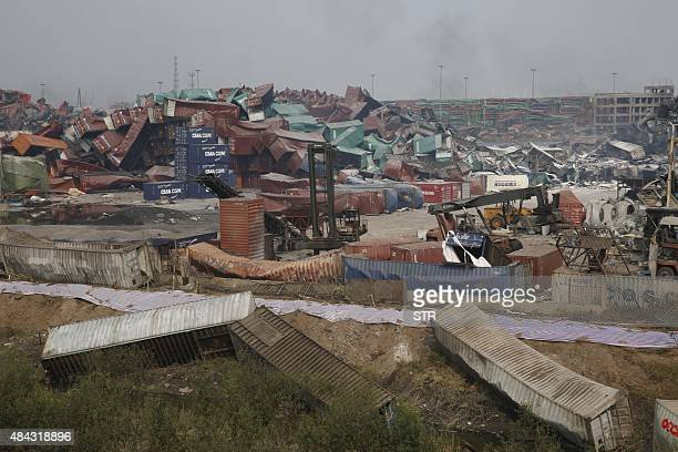 This general view shows the damage to shipping containers in Tianjin on August 17 2015 at the site of the explosions last week that hit a chemical...