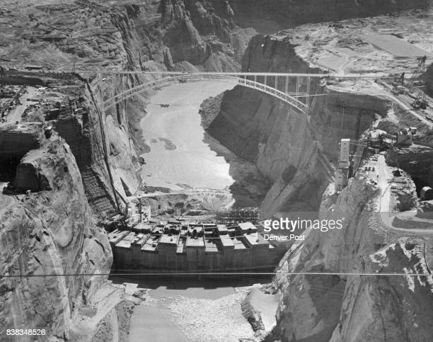 This general view shows the Glen Canyon Dam taking form on the Colorado River at Page Ariz near the Utah line The dam one of the most spectacular...