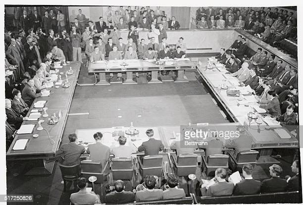This general view shows the last session of Indochina truce negotiators. The ceasefire pact was signed the following day. Anthony Eden is at table on...