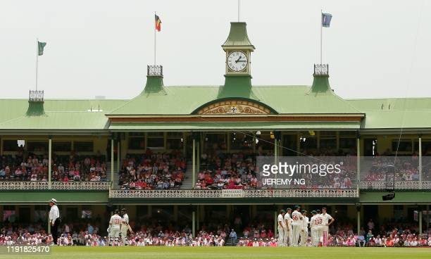 This general view shows the members stand as both teams await on a DRS review during the third day of the third cricket Test match between Australia...