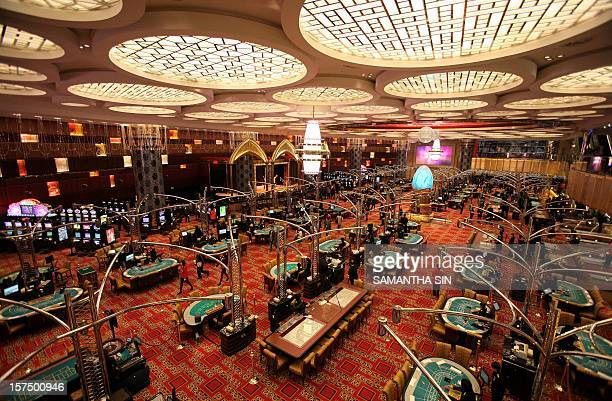 This general view shows the new tables at the Grand Lisboa hotel and casino during a press preview ahead of the casino's opening in Macau 11 February...