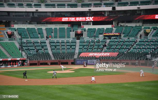 This general view shows the opening game for South Korea's new baseball season at Munhak Baseball Stadium in Incheon on May 5 2020 South Korea's...