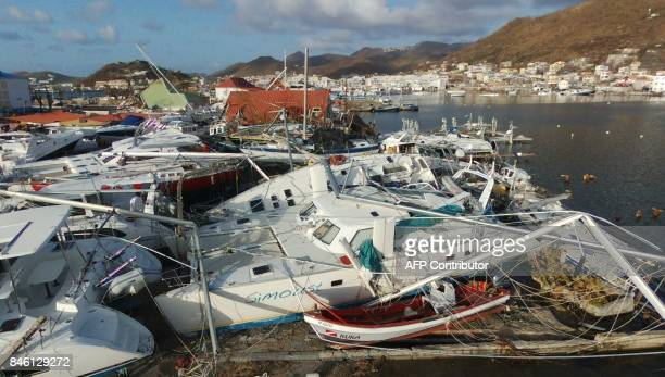 This general view shows the wreckage of boats in the Geminga shipyard of Marigot on September 12 in Saint Martin island which was devastated by...