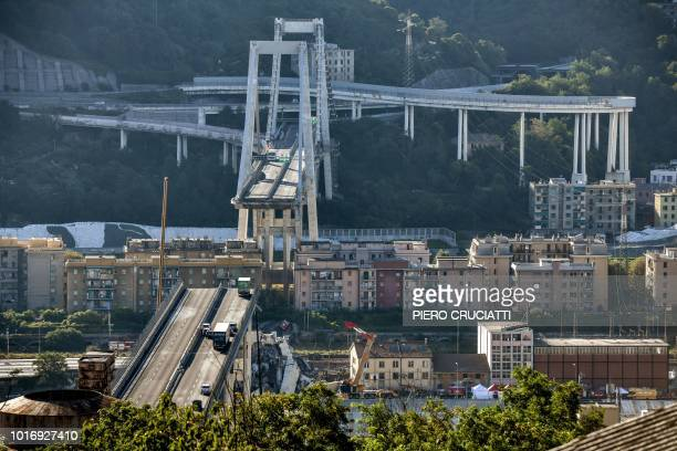 TOPSHOT This general view taken on August 15 shows abandoned vehicles on the Morandi motorway bridge after a section collapsed in the northwestern...