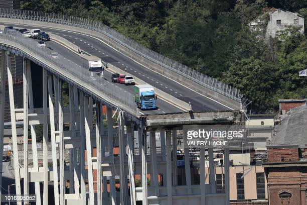 TOPSHOT This general view taken on August 15 shows abandoned vehicles on the Morandi motorway bridge the day after a section collapsed in the...