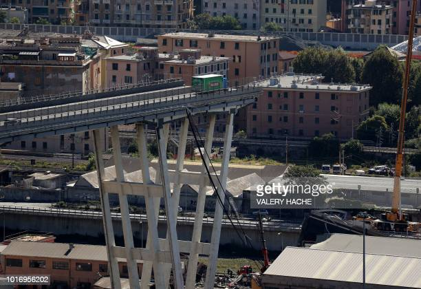This general view taken on August 15 shows an abandoned truck on the Morandi motorway bridge after a section collapsed in the northwestern Italian...