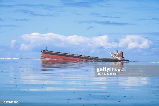 This general view taken on August 7 shows the vessel MV Wakashio, belonging to a Japanese company but Panamanian-flagged, that ran aground near Blue...