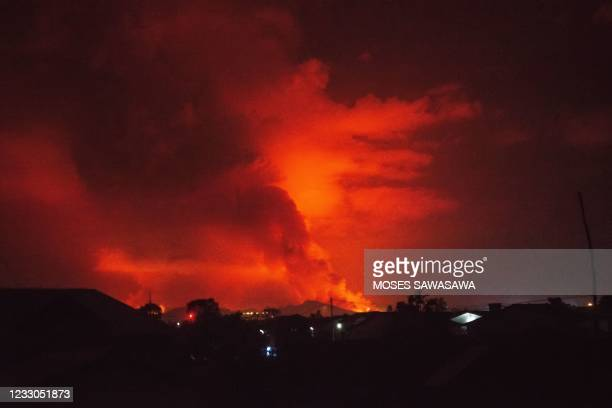 This general view taken on May 22, 2021 in Goma in the East of the Democratic Republic of Congo shows flame spewing from the Nyiragongo volcano. -...