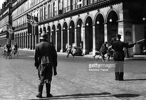 This German soldier is on guard in the middle of rue Rivoli in front of rue Castiglione and the Intercontinental Hotel where the Gestapo has its...