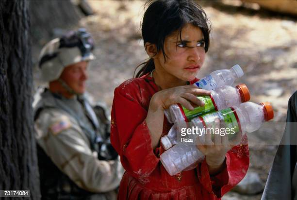 This girl collects plastic bottles thrown away by the American soldiers on July 2004 in Afghanistan