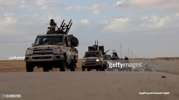 This grab obtained from a video published on the LNA War Information Division's Facebook page on April 3 allegedly shows military convoys heading...