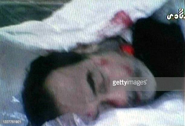 This grab taken from a video broadcast by Iraqi private network Biladi TV 30 December 2006 shows the dead body of former Iraqi leader Saddam Hussein...