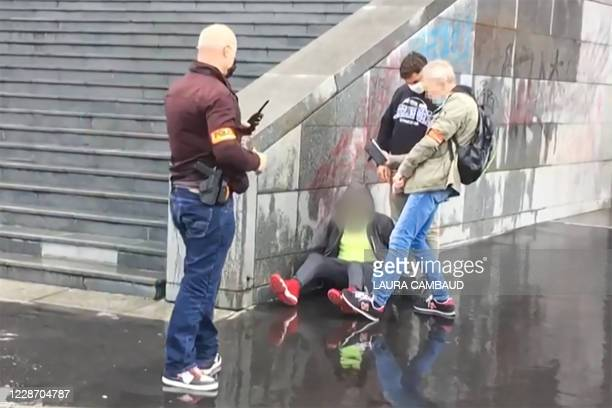 This grab taken from a video obtained by AFP shows French police detaining an alleged suspect after several people were injured near the former...