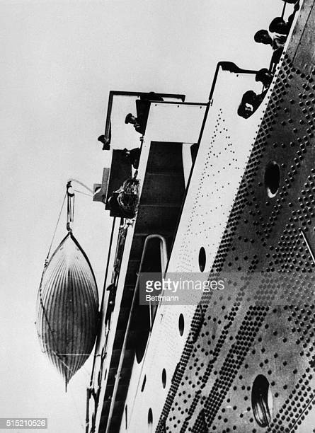 This grimly prophetic photo of the Titanic's bridge and one of its lifeboats was made by Reverend F.M. Browne, a passenger who got off the doomed...