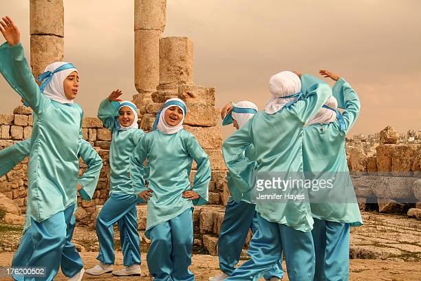 CONTENT] This group of school girls dance to celebrate the birth of the prophet Mohammed Citadeel Amman Jordan