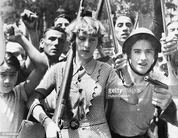 This group of Spanish workers armed by the government to fight against the rebels includes a woman carrying a rifle and bayonet Madrid Spain ca 1936...