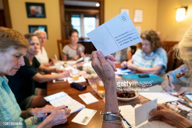 This group of women gather every week in each others homes to write postcards in the Mt Airy neighborhood of Philadelphia Pennsylvania on August 3...