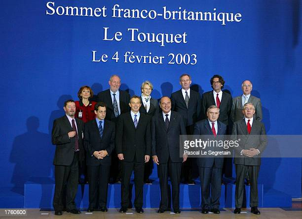 This group photo shows attendees at the 25th FrancoBritish summit FEbruary 4 2003 in Le Toquet France First row are British MP David Blunkett French...