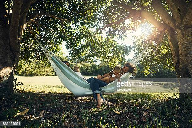 this hammock is family-sized - hammock stock pictures, royalty-free photos & images