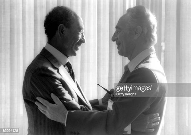 This handout file photo provided by the Israeli Government Press Office on March 25 shows visiting Egyptian President Anwar Sadat greeting then...