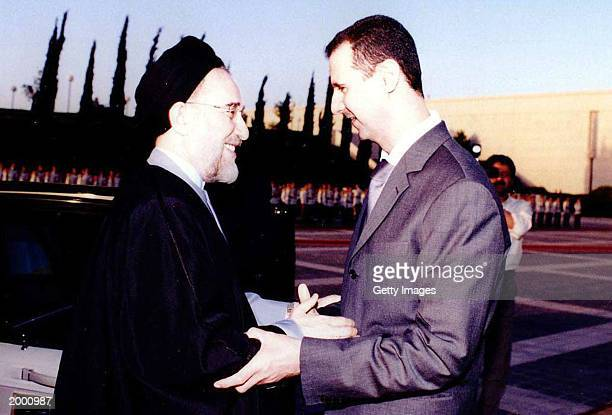 This handout image by the official Syrian news agency SANA shows Syrian President Bashar alAssad receiving Iranian President Mohammad Khatami May 14...