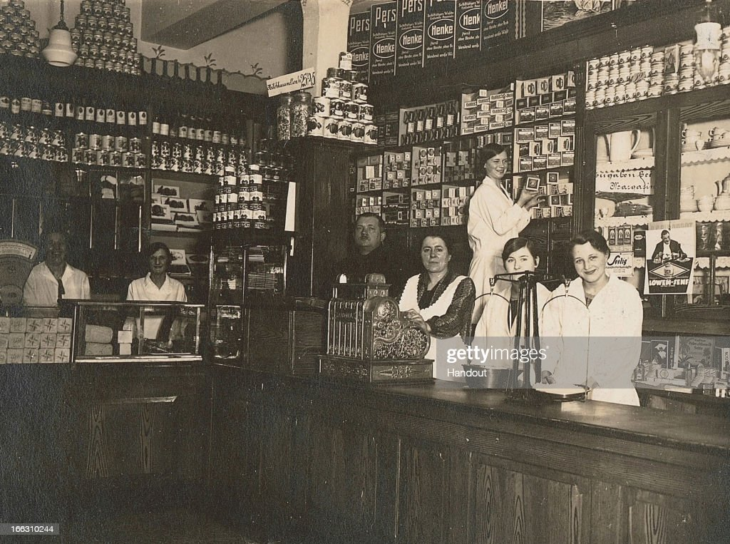 This handout image dated 1930 provided by ALDI Einkauf GmbH & Co. oHG shows an inside outside view and employees of Karl Albrecht Spiritousen and Lebensmittel shop, at Huestrasse 89 in Essen-Schonnebeck, Germany. The small store in a suburb of Essen was founded by the mother of Karl and Theo Albrecht in 1913. Aldi, which today is among the world's most successful discount grocery store chains, will soon mark its 100th anniversary and traces its history back to Karl Albrecht, who began selling baked goods in Essen on April 10, 1913 and founded the Aldi name by shortening the phrase Albrecht Discount. His sons Karl Jr. and Theo expanded the chain dramatically, creating 300 stores by 1960 divided between northern and southern Germany, with Aldi Nord and Aldi Sued, respectively. Today the two chains have approximately 4,300 stores nationwide and have also expanded into other countries across Europe and the USA. Aldi Nord operates in the USA under the name Trader Joe's.