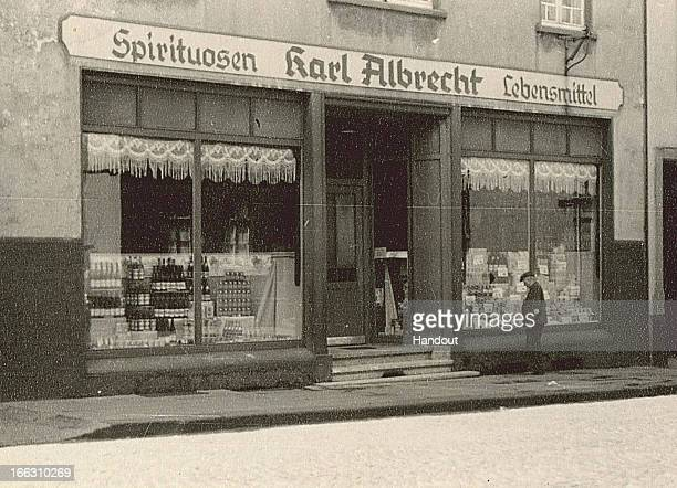 This handout image dated 1930 provided by ALDI Einkauf GmbH & Co. OHG shows an general outside view of Karl Albrecht Spiritousen and Lebensmittel...